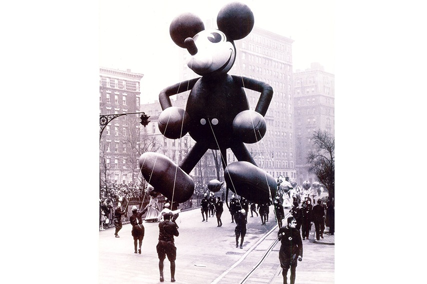 1934 comes around, and Mickey Mouse is introduced to the party! The first enormous balloon version of the popular mouse was designed with the help of Walt Disney.
