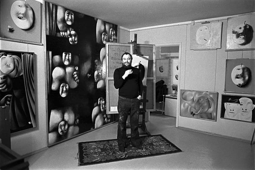 Oleg Tselikov; the artist in front of his paintings