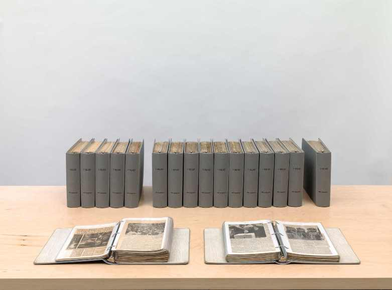 On Kawara, I Read, 1966–95, Clothbound loose-leaf binders with plastic sleeves and inserted printed matter, Eighteen volumes. Inserts: Newspaper pasted on paper with ink additions. Front-page inserts: Newspaper with ink additions. Collection of the artist