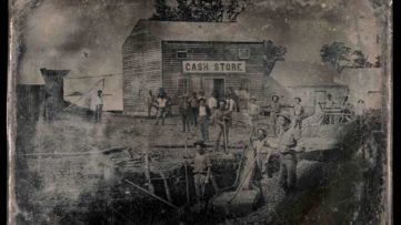 Outdoor Scene with Unidentified Group of Miners in Front of Cash Store