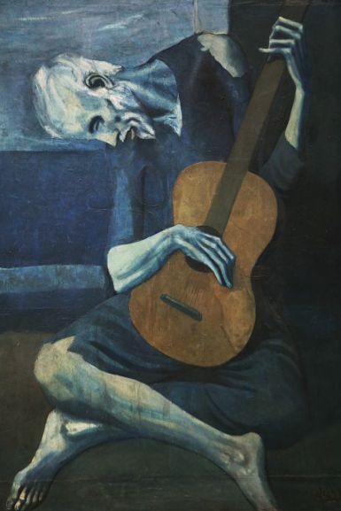 Pablo Picasso - The Old Guitarist, gallery view, 1903-04, woman in a portrait gallery