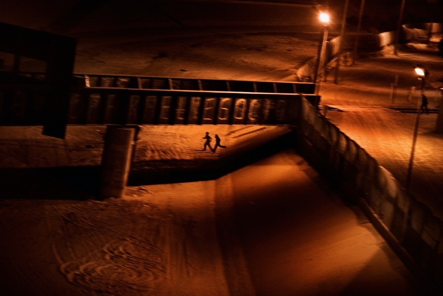 Paolo Pellegrin - Two men who attempted to enter the U.S. illegally
