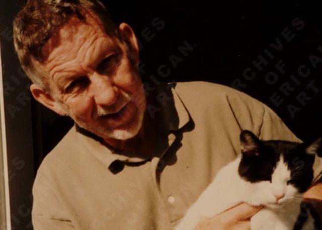 Paul Wonner with cat at front door Jersey St., San Francisco, 1981