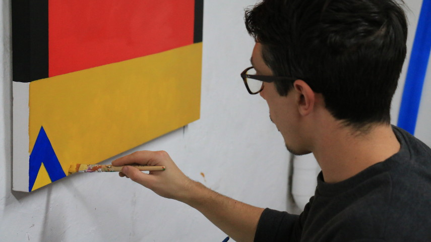 Photo of the Artist Painting in His Studio