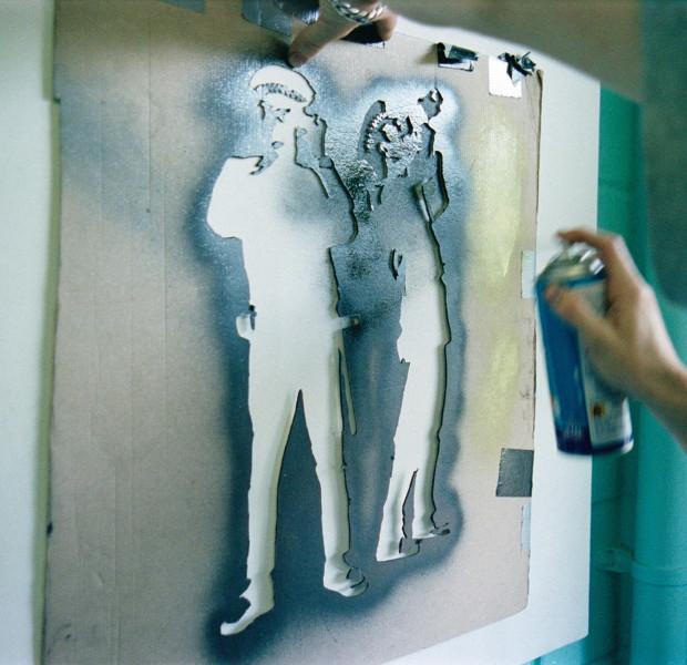Banksy stenciling, Photograph by Steve Lazarides, circa 2000 - 2002