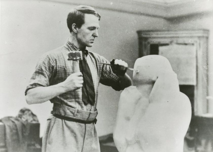 henry moore carving the white stone statue