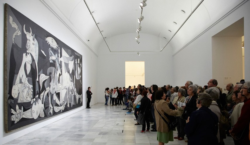 Photo of Picasso's Guernica being displayed in a woman museum show