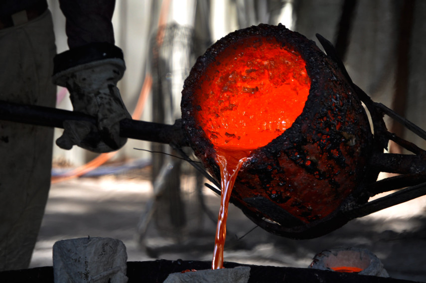 Pouring Molten Bronze into a Mold for a museum bronze sculpture