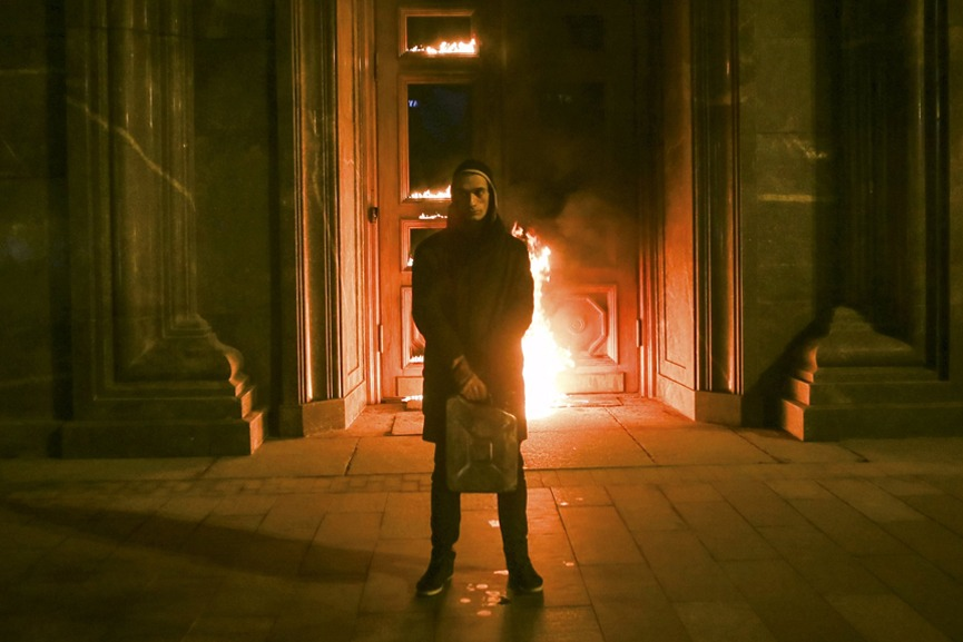 Pyotr Pavlensky during The Burning Door of the Lubyanka Performance