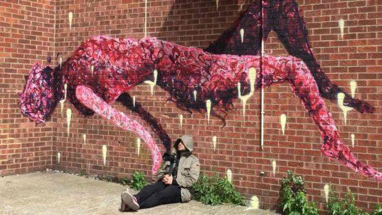 Rafael Sliks - Artist siting in front of his work - Photo Credits Rafael Sliks