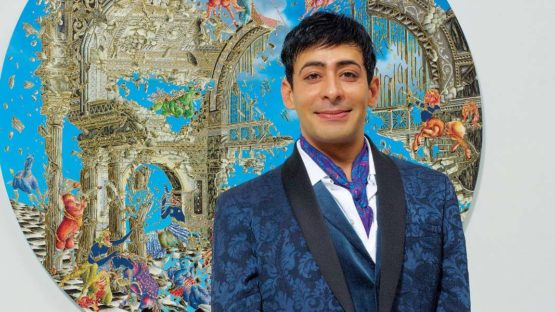 Raqib Shaw - with a work of his - courtesy Pace Gallery