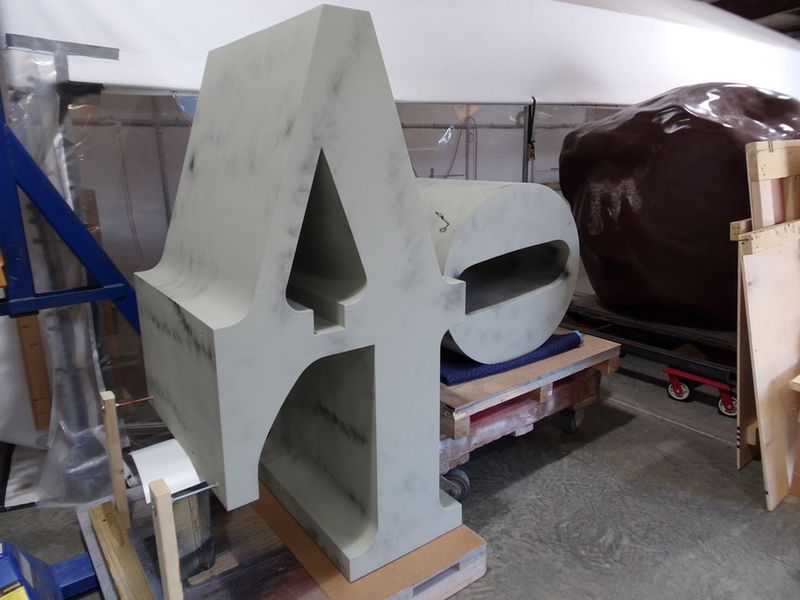Repainting of the Sculpture; indiana decided to use original design in 1964 and place the sculpture on view in front of the museum