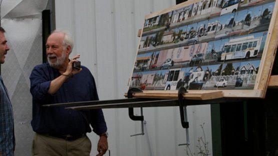 Robbert Flick in front of his artwork
