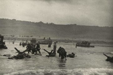 Robert Capa - American soldiers landing on Omaha Beach, D-Day, Normandy, France, June 6, 1944