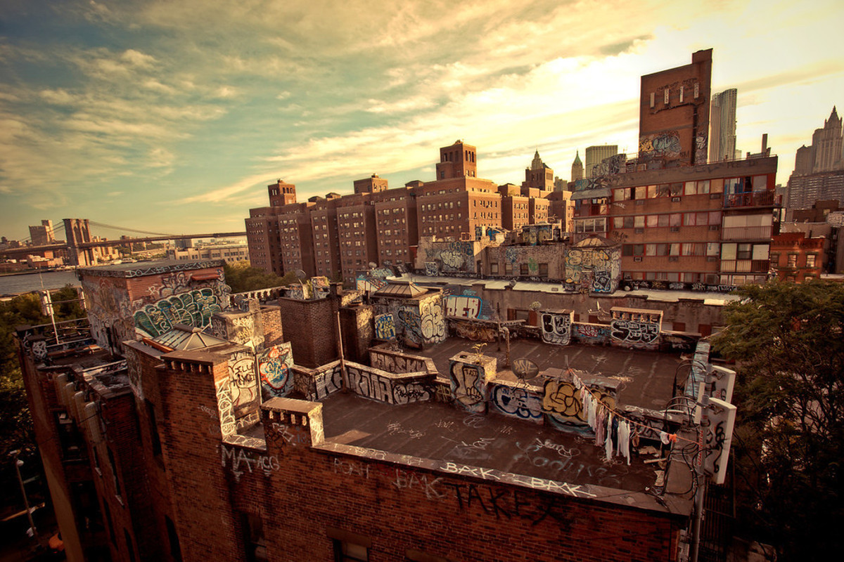 Rooftop Graffiti in Chinatown Looking Towards the Brooklyn Bridge - The public community of a city loves to view the spray paint program of street art