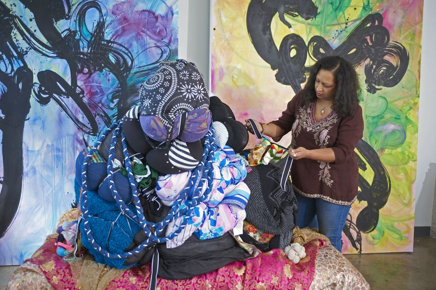 Shinique Smith in her studio with Mitumba Deity II, 2018-19, on view during Art Basel Miami fair 2019