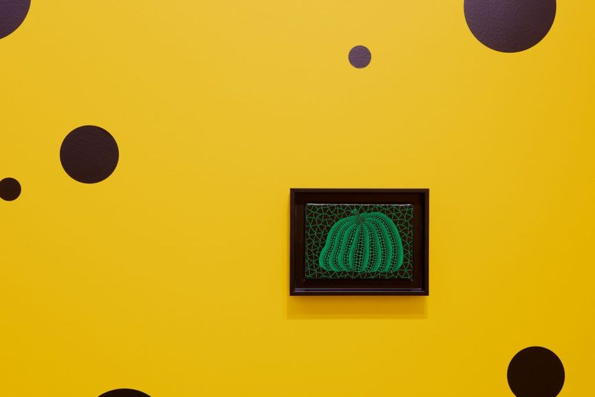 Small Pumpkin Paintings by Yayoi Kusama in the museum; an arts image from 2017