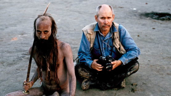 Steve McCurry poses with a man at the Kumbha Mela Festival,India 2001