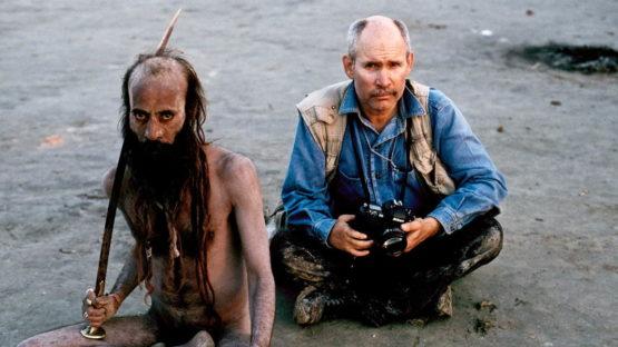 Steve McCurry poses with a man at the Kumbha Mela Festival,India 2001