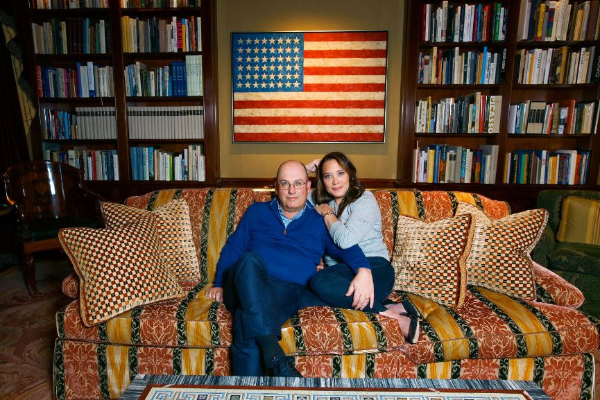 Steve and Alex Cohen, at home in front of Jasper Johns' Flag