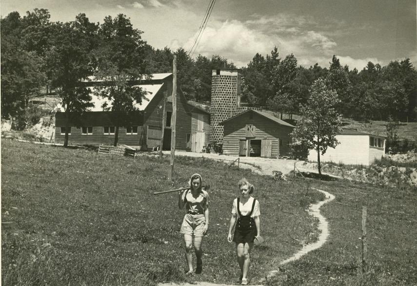 A picture of two female students walking back to school after visiting Black Mountain College's Barn and Silo - John Rice went to the north carolina faculty after being in Black Mountain College
