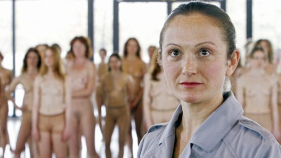Vanessa Beecroft - The artist in front of her work - Image via vogueit