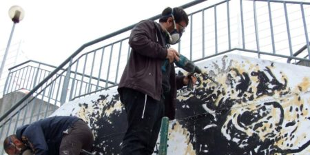 Vhils - Photo of the artist at work, 2017 - Image via stick2target portuguese video of banksy