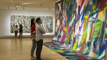 Visitors in the exhibition Mural: Jackson Pollock | Katharina Grosse at the Museum of Fine Arts, Boston