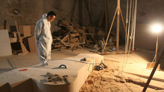 Wang Jianwei working at his Bejing studio, 2014, Photo by Xu Boxin