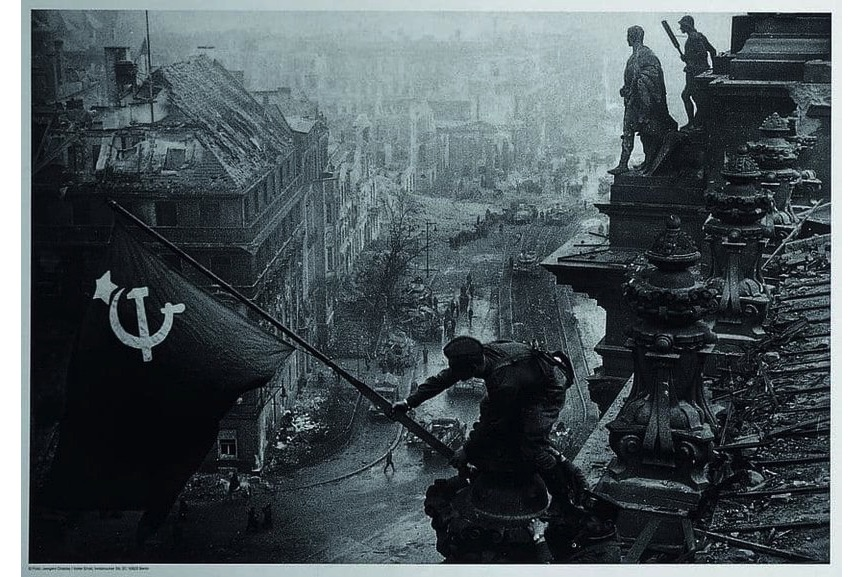 Yevgeny Khaldei, Soviet soldiers raising the red flag over the Reichstag, May 1945