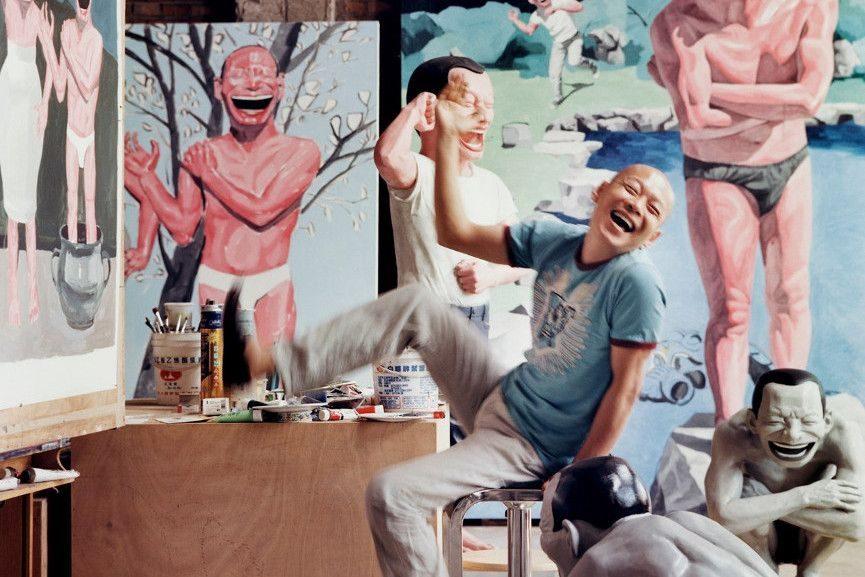 Yue Minjun In His Studio - Image via pinterestcom