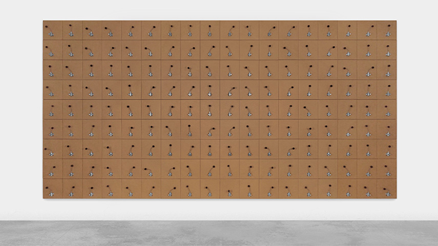 in his work, zimoun arranges a play with objects like boxes, ventilators and cotton balls. his pieces are often installed on a wall.