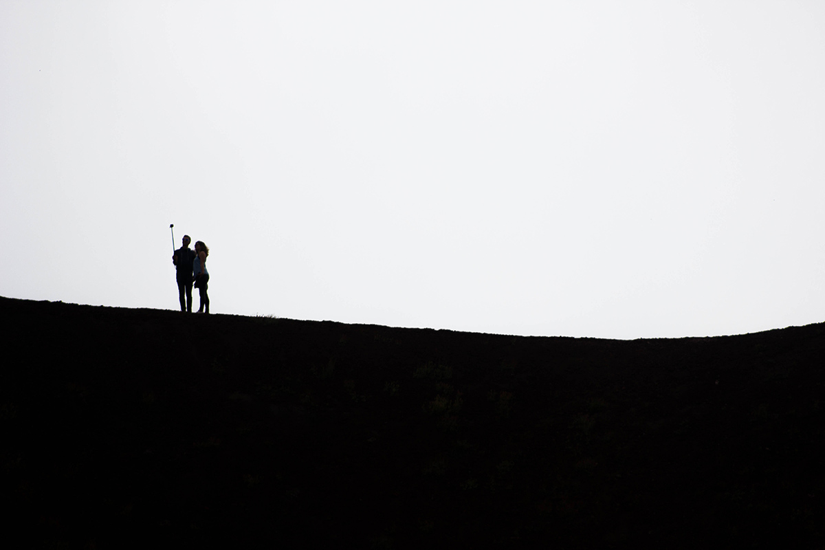 A couple taking a picture on top of a landscape, via pxhere.com